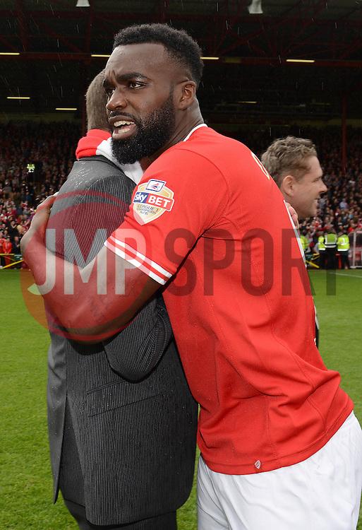 Bristol City's Karleigh Osborne  celebrates with Jon Lansdown - Photo mandatory by-line: Dougie Allward/JMP - Mobile: 07966 386802 - 03/05/2015 - SPORT - Football - Bristol - Ashton Gate - Bristol City v Walsall - Sky Bet League One