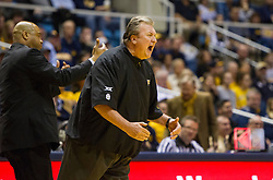 Jan 26, 2016; Morgantown, WV, USA; West Virginia Mountaineers head coach Bob Huggins argues a call during the first half against the Kansas State Wildcats at the WVU Coliseum. Mandatory Credit: Ben Queen-USA TODAY Sports