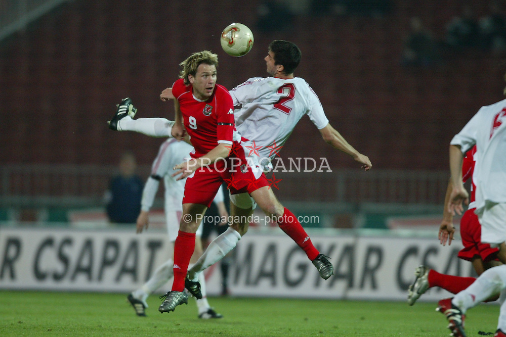 BUDAPEST, HUNGARY - Wednesday, March 31, 2004: Wales' Gareth Taylor and Hungary's Adam Komlosi during the International Friendly match at the Ferenc Puskas Stadium. (Pic by David Rawcliffe/Propaganda)