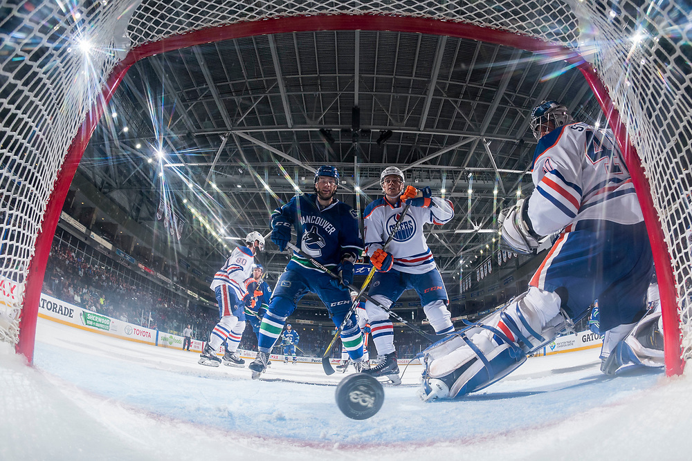 PENTICTON, CANADA - SEPTEMBER 11: Austin Glover #67 and Aaron Irving #40 of Vancouver Canucks watch the puck go past Stuart Skinner #50 of Edmonton Oilers on a shot by Michael Carone #58 of Vancouver Canucks on September 11, 2017 at the South Okanagan Event Centre in Penticton, British Columbia, Canada.  (Photo by Marissa Baecker/Shoot the Breeze)  *** Local Caption ***