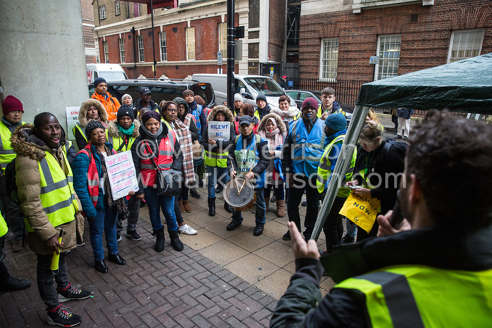 London, UK. 25 November, 2019. Petros Elia, co-founder of the United Voices of the World (UVW) trade union, addresses outsourced workers belonging to the union on the picket line outside their workplace at St Mary's Hospital Paddington. Outsourced to Imperial College Healthcare NHS Trust via Sodexo, one of the world's largest multinational corporations, around 200 migrant cleaners, porters and caterers are striking to become NHS employees and have declared an indefinite strike in January 2020. Credit: Mark Kerrison/Alamy Live News