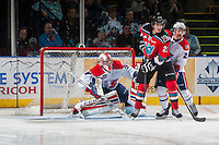 KELOWNA, CANADA - NOVEMBER 7: Garret Hughson #30 defends the net as Matt Sozanski #21 of Spokane Chiefs checks Justin Kirkland #23 of Kelowna Rockets on November 7, 2014 at Prospera Place in Kelowna, British Columbia, Canada.  (Photo by Marissa Baecker/Shoot the Breeze)  *** Local Caption *** Justin Kirkland; Matt Sozanski; Garret Hughson;