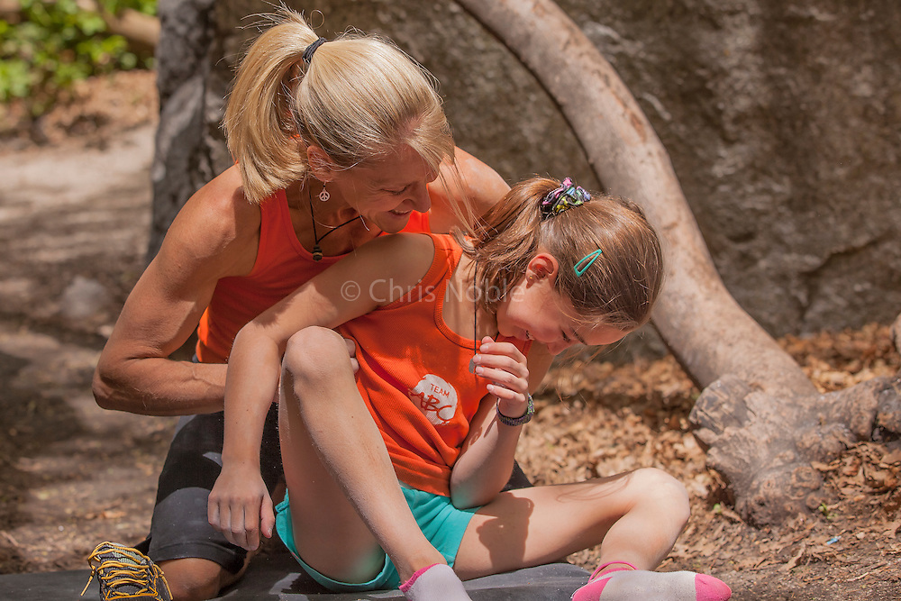 Champion climber Robyn Erbesfield-Raboutou and her daughter Brooke Raboutou playing together following a bouldering session.