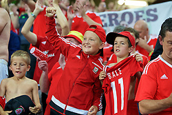LILLE, FRANCE - Friday, July 1, 2016: Young Wales supporters hold a Gareth Bale shirts as they celebrate the 3-1 victory against Belgium at full time after the UEFA Euro 2016 Championship Quarter-Final match at the Stade Pierre Mauroy. (Pic by Paul Greenwood/Propaganda)