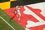 Wide receiver Devin Smith (R) of the Ohio State Buckeyes catches a touchdown pass against safety Sean Davis of the Maryland Terrapins in College Park, Maryland.