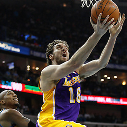 February 5, 2011; New Orleans, LA, USA; Los Angeles Lakers power forward Pau Gasol (16) shoots over New Orleans Hornets power forward David West (30) during the first quarter at the New Orleans Arena.   Mandatory Credit: Derick E. Hingle