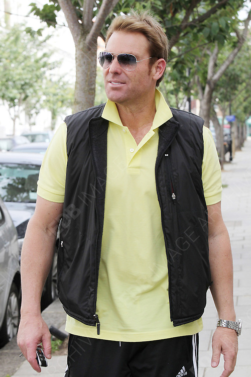 28.JUNE.2012. LONDON<br /> <br /> SHANE WARNE LEAVING LIZ HURLEY'S HOUSE IN FULHAM. <br /> <br /> BYLINE: EDBIMAGEARCHIVE.CO.UK<br /> <br /> *THIS IMAGE IS STRICTLY FOR UK NEWSPAPERS AND MAGAZINES ONLY*<br /> *FOR WORLD WIDE SALES AND WEB USE PLEASE CONTACT EDBIMAGEARCHIVE - 0208 954 5968*