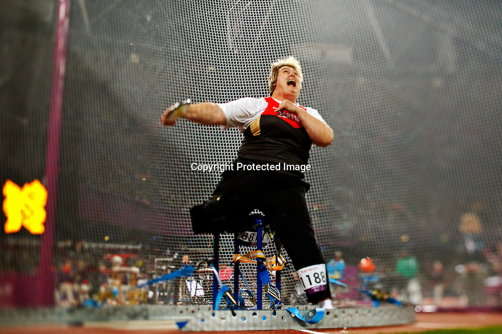 A picture taken with a tilt and shift lens shows Ilke Wyludda of Germany competing in the Women's Discus Throw F57/58 final at Olympic Stadium during the London 2012 Paralympic Games, London, Britain, 04 September 2012.  EPA/KERIM OKTEN