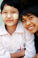 Myanmar/Burma. Two young girls with thanaka on their faces.