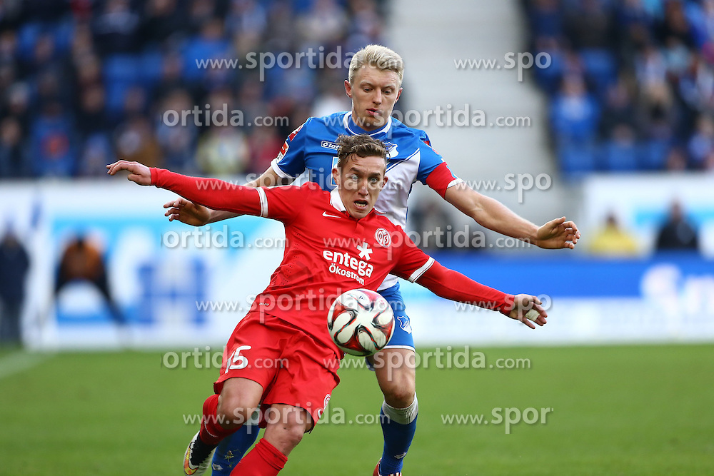 28.02.2015, Rhein Neckar Arena, Sinsheim, GER, 1. FBL, TSG 1899 Hoffenheim vs 1. FSV Mainz 05, 23. Runde, im Bild Andreas Beck (TSG 1899 Hoffenheim) im Zweikampf mit Nicolas Castillo (FSV Mainz 05), Aktion / Action // during the German Bundesliga 23rd round match between TSG 1899 Hoffenheim and 1. FSV Mainz 05 at the Rhein Neckar Arena in Sinsheim, Germany on 2015/02/28. EXPA Pictures &copy; 2015, PhotoCredit: EXPA/ Eibner-Pressefoto/ Neis<br /> <br /> *****ATTENTION - OUT of GER*****