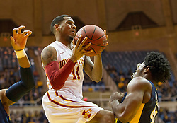 Feb 22, 2016; Morgantown, WV, USA; Iowa State Cyclones guard Monte Morris (11) shoots over West Virginia Mountaineers forward Devin Williams (41) during the first half at the WVU Coliseum. Mandatory Credit: Ben Queen-USA TODAY Sports