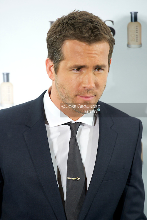 US Actor Ryan Reynolds presents 15th anniversary 'Boss Bottled' Fragrance at Eurostars Hotel on November 26, 2013 in Madrid