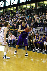 30 December 2006: Andrew Holms picks up his dribble when approached by Kevin Bryant. The Titans outscored the Britons by a score of 94-80. The Britons of Albion College visited the Illinois Wesleyan Titans at the Shirk Center in Bloomington Illinois.<br />