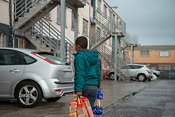"The kids of a community marshall distribute bread to their neighbours delivered by volunteers to the community of Parkwood, a subburb of Cape Town, located on the Cape Flats, Monday, April 20, 2020. The majority of the people who live here are unemployed during ""normal"" circumstances. And as South Africa is now in lockdown due to the Coronavirus, many of those who had jobs have also lost their income. So many people are starving. The feeding scheme is a joint community effort, paid for solely by donations from the public to feed more than 3,000 households. The group is also receiving transportation support by The South African Red Cross Society. PHOTO: EVA-LOTTA JANSSON"