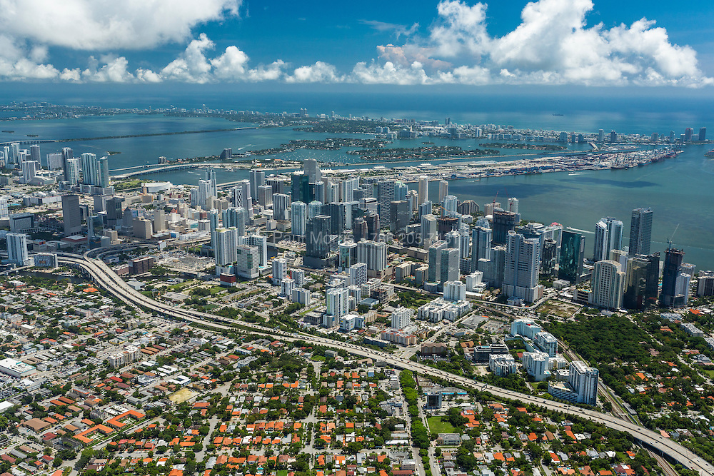 High angle aerial view looking down on downtown Miami from South to North with Brickell in the foreground looking east