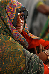 Chitrakoot, Uttar Pradesh, India: Dalit women come together for a conference led by the women's group Vanangana in Chitrakoot, Uttar Pradesh, India February 12, 2006.  Chitrakoot district has a high level of poverty, feudalism, violence. Some of the women are a part of a group that brought out a newspaper in the local dialect for a rural audience, and to create awareness. Khabar Lahariya, is a fortnightly rural newspaper produced by the group of seven, predominantly dalit and kol women. The publication began in May 2002 and presently has a print run of 1500.  In Chitrakoot district, as in other parts of India, mainstream newspapers do not reach large sections of the rural population nor do they meet their local news and information needs. Khabar Lahariya provides a mix of news, information and entertainment. Khabar Lahariya's hallmark is the local. Its strength is credible investigative reportage. It covers current political news, stories on the functioning of panchayats, the bureaucracy, schools, hospitals and reports atrocities on women and marginalized sections of society.(Photo by Ami Vitale)