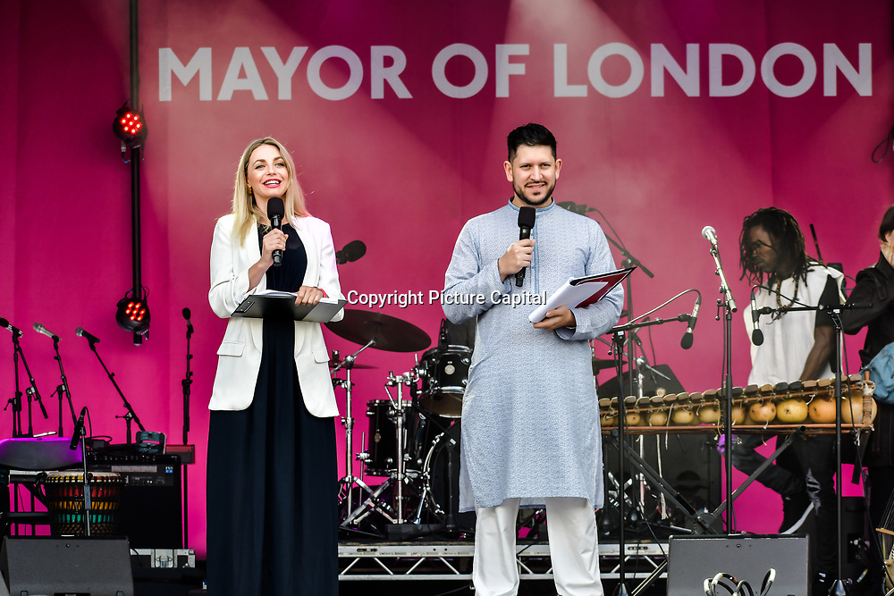 Abdullah Afzal and Myriam Francois presenters at the Eid festival in Trafalgar Square London to mark the end of Ramadan on 8 June 2019, London, UK.
