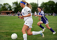 11 MAY 2012 -- ALTON, Ill. -- Alton Marquette High School soccer player Cassie McFadden (19) pushes the ball past Civic Memorial High School's Mackenzie Maberry (8) during the Class 1A Regional Finals at Gordon Moore Park in Alton Friday, May 11, 2012. Photo © copyright 2012 Sid Hastings.