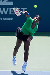 July 31, 2011; Stanford, CA, USA;  Serena Williams (USA) serves the ball against Marion Bartoli (FRA), not pictured, during the finals of the Bank of the West Classic women's tennis tournament at the Taube Family Tennis Stadium.