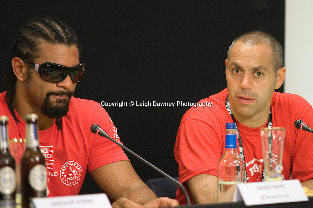 David Haye & Adam Booth at press conference following the World Heavyweight Title fight at Imtech Arena, Hamburg, Germany. 03.07.11.  Photo credit: Leigh Dawney 2011