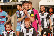 Paul McGinn (C) of St Mirren applauds the fans as he leads out his team ahead of the Ladbrokes Scottish Premiership match between St Mirren and Dundee at the Paisley 2021 Stadium, St Mirren, Scotland on 30 March 2019.