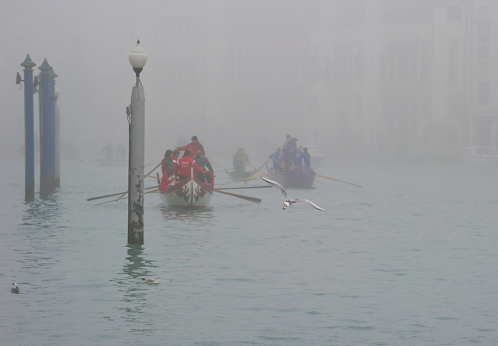 VENICE, ITALY - JANUARY 16:  Rowers boats are seen through a thick fog on the Canal Grande on the day of the opening of the Venetian rowing season on January 16, 2011 in Venice, Italy. Transports in the lagoon has been affected by today's fog.