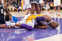 27 January 2013: Guard (24) Kobe Bryant of the Los Angeles Lakers falls to the ground hard while driving to the basket and being guarded by Kendrick Perkins of the Oklahoma City Thunder during the second half of the Lakers 105-96 victory over the Thunder at the STAPLES Center in Los Angeles, CA.