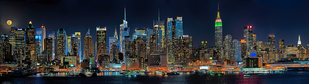 Manhattan skyline with full moon, Times Square Lights go Blue