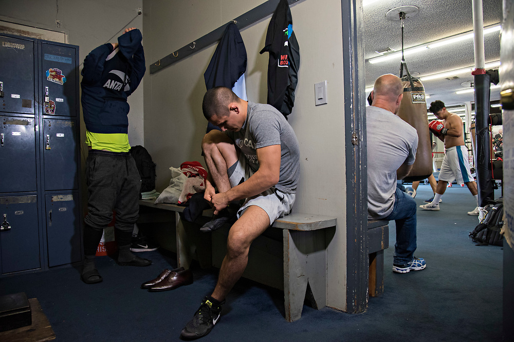 June 8, 2017 / Hollywood, Calif.<br /> <br /> Coming straight from a media event at the Viacom Headquarters hyping his much-anticipated MMA debut, Aaron Pico, 20, spends a few quiet moments changing out of his suit and into his gym clothes in the locker room at Wild Card Boxing Club. (Melissa Lyttle for ESPN)