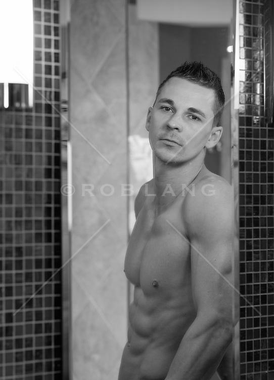 shirtless man in a bathroom