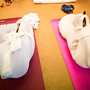 "TOKYO, JAPAN - JANUARY 29 : Participants wrapped with white cloth during a workshop called ""Otonamaki"", which directly translates to adult wrapping in Tokyo, Japan on Sunday, January 29, 2017. Otonamaki is a Japanese therapeutic method meant to alleviate posture problems and stiffness. (Photo by Richard Atrero de Guzman/ANADOLU Agency)"