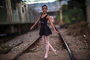 Andressa Vitoria of the Manguinhos community ballet, poses for a picture in the degraded surroundings of the Biblioteca Parque public library in Manguinhos neighbourhood in Rio de Janeiro, Brazil, Monday, June 11, 2018.  The Manguinhos community ballet has been a reprieve from the violence and poverty that afflicts its namesake neighborhood for hundreds of girls who have benefitted from free dance classes since 2012. (Dado Galdieri for The New York Times)
