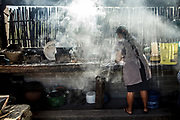Cooking over a wood stove. Oaxaca, Mexico.