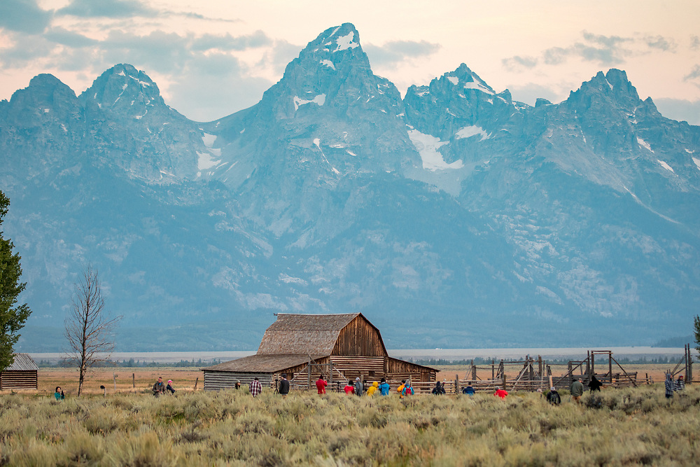 Group of photographers set up cameras in front of John Moulton Barn and Teton Mountain Range, Grand Tetons National Park, Teton County, Wyoming