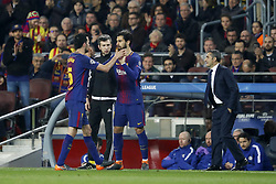 (L-R) Sergio Busquets of FC Barcelona, Andre Gomes of FC Barcelona, coach Ernesto Valverde of FC Barcelona during the UEFA Champions League round of 16 match between FC Barcelona and Chelsea FC at the Camp Nou stadium on March 14, 2018 in Barcelona, Spain.