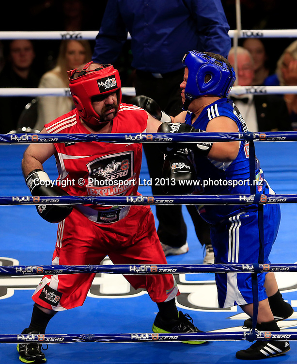 Matthew Wood (blue) and Colin Lane tuff it out. Boxing, Hyrd8 Zero Explosion, Fight Night, Trusts Arena, Auckland, Thursday 13th June 2013. Photo: Shane Wenzlick / Photosport.co.nz