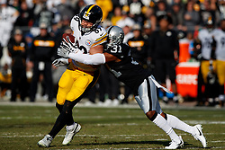 OAKLAND, CA - DECEMBER 09: Tight end Vance McDonald #89 of the Pittsburgh Steelers is tackled by safety Marcus Gilchrist #31 of the Oakland Raiders during the second quarter at the Oakland Coliseum on December 9, 2018 in Oakland, California. The Oakland Raiders defeated the Pittsburgh Steelers 24-21. (Photo by Jason O. Watson/Getty Images) *** Local Caption *** Vance McDonald; Marcus Gilchrist