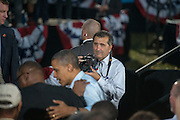 Chief Official White House photographer and Assistant Professor in Visual Communications at Ohio University, Pete Souza, photographs President Obama at a rally on the campus of Ohio Unviersity. Photo by Ben Siegel/ Ohio University