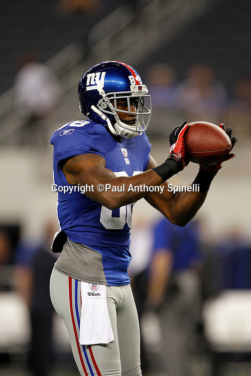 New York Giants wide receiver Hakeem Nicks (88) catches a pregame pass during the NFL week 7 football game against the Dallas Cowboys on Monday, October 25, 2010 in Arlington, Texas. The Giants won the game 41-35. (©Paul Anthony Spinelli)