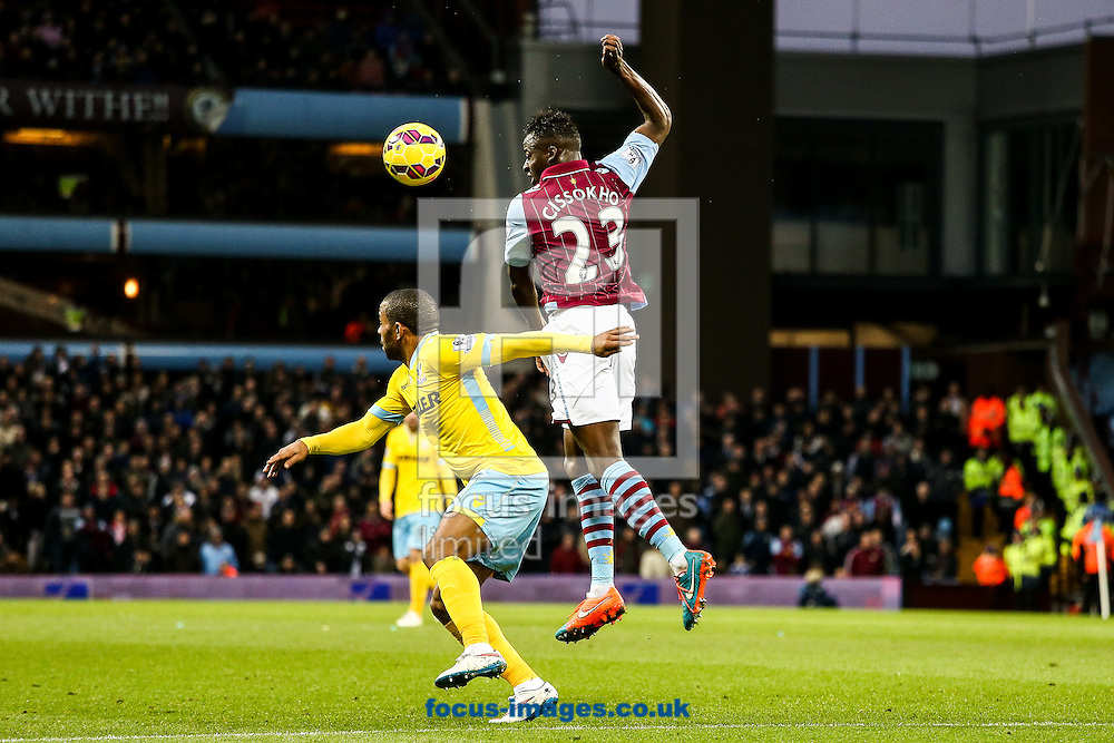 Aly Cissokho of Aston Villa (centre) cuts out a cross during the Barclays Premier League match at Villa Park, Birmingham<br /> Picture by Andy Kearns/Focus Images Ltd 0781 864 4264<br /> 01/01/2015