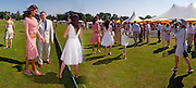 Natalya Petouchkova, John Stephen and Jamime Murray treading the divots<br /> . Veuve Clicquot Gold Cup Final at Cowdray Park. Midhurst. 17 July 2005. ONE TIME USE ONLY - DO NOT ARCHIVE  © Copyright Photograph by Dafydd Jones 66 Stockwell Park Rd. London SW9 0DA Tel 020 7733 0108 www.dafjones.com