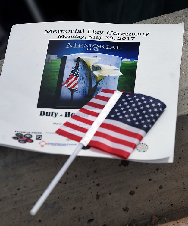 jt052917h/ a sec/jim thompson/A program and a American flag for the  Memorial Day Ceremony held at the New Mexico Veteran's Memorial. Monday May. 29, 2017. (Jim Thompson/Albuquerque Journal)