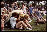 Taiko Do Jo drummer dances among crowd in lion costume @ Japanese Festival;Mo Botanical Garden,StL Missouri