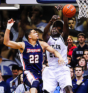 INDIANAPOLIS, IN - FEBRUARY 19: Kadeem Pantophlet #22 of the Duquesne Dukes strips the ball from Khyle Marshall #23 of the Butler Bulldogs at Hinkle Fieldhouse on February 19, 2013 in Indianapolis, Indiana. Butler defeated Duquesne 68-49. (Photo by Michael Hickey/Getty Images) *** Local Caption *** Kadeem Pantophlet; Khyle Marshall