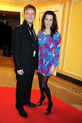 JOHN SIMM and KATE McGOWAN at the 2009 South Bank Show Awards held at The Dorchester, Park Lane, London on 20th January 2009.
