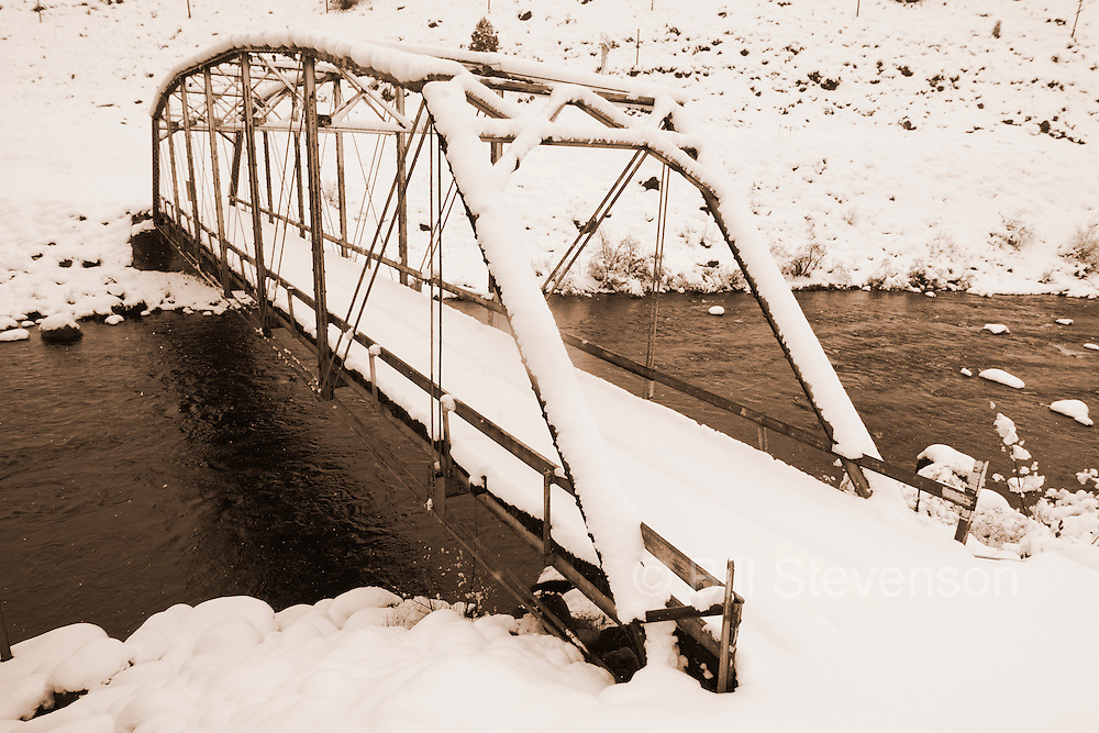An image of an old snow covered bridge across the Truckee River near Truckee, California.