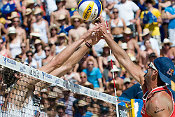 Todd Rogers of USA pokes over Matt Fuerbringer's block at A1 Beach Volleyball Grand Slam tournament of Swatch FIVB World Tour 2010, final, on August 1, 2010 in Klagenfurt, Austria. (Photo by Matic Klansek Velej / Sportida)