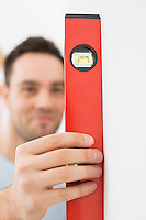 Man using spirit level in new house
