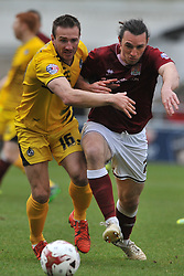 BRISTOL ROVERS TOM LOCKYER HOLDS OF NORTHAMPTONS JOHN MARQUIS, NORTHAMPTON TOWN JOHN JOE O'TOOLE BATTLES WITH BRISTOLS LIAM LAWRENCE, Northampton Town v Bristol Rovers, Sky Bet League Two, Sixfields Stadium, Saturday 9th April 2016, (Score 2-2) Northampton Promoted to League One,