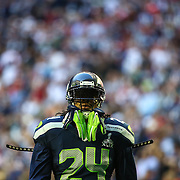 Seahawks player Marshawn Lynch paces on the field before Super Bowl XLIX against the New England Patriots at University of Phoenix Stadium. The Seahawks lost to the Patriots 28 to 24. Photographed on Sunday, February 1, 2015.  (Joshua Trujillo, seattlepi.com)